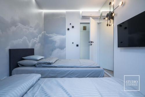 apartament-golden-sypialnia-chmury-wyjscie
