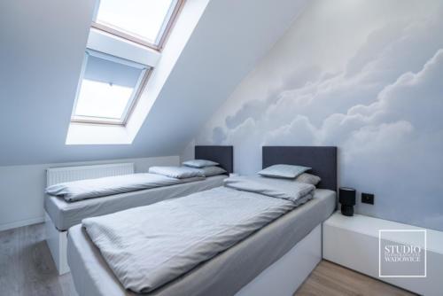 apartament-golden-sypialnia-chmury